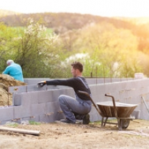 graphicstock-bricklayer-putting-down-another-row-of-bricks-in-site_rC-7N0cTbW_thumb