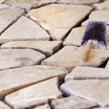 graphicstock-masons-mortar-laid-on-an-unfinished-stone-floor_S0xYdJ6abb_thumb
