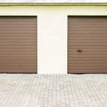 Pair of modern garage doors. Large automatic up and over garage doors for a wealthy holiday home.